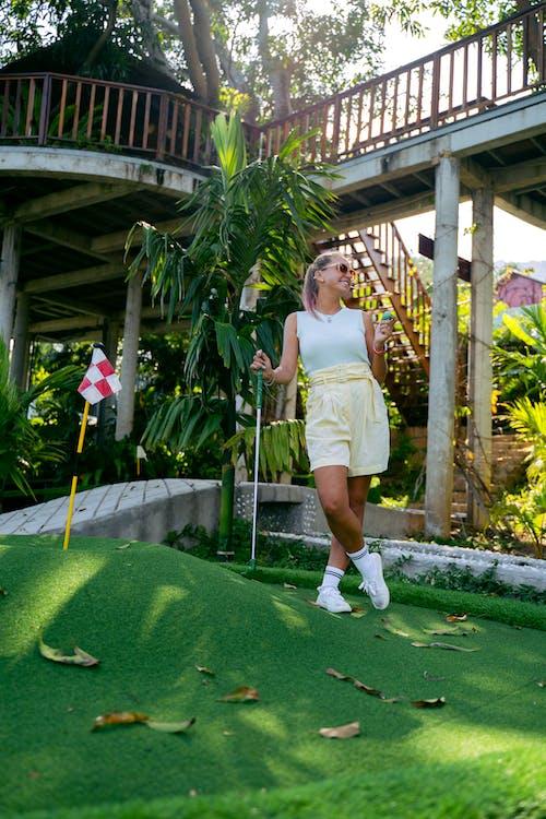 A Woman Holding a Golf Ball