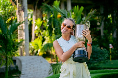 A Woman Holding a Trophy
