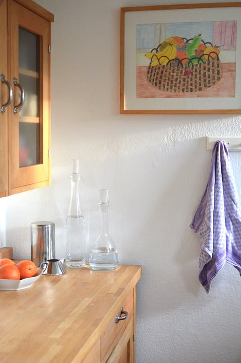 Kitchen cupboard and counter with various dishware