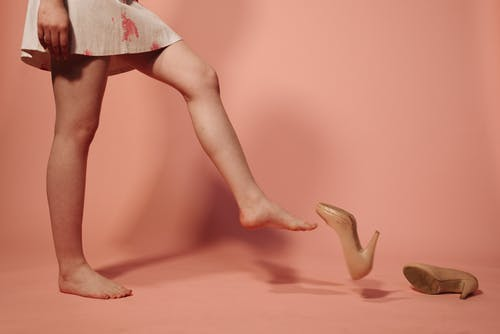 A Woman Removing Her Shoes