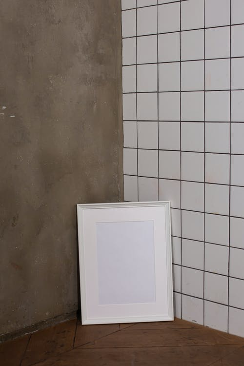 Empty white frame near wall