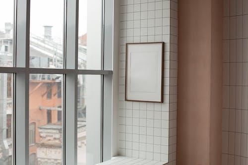 Empty photo frame hanging near window