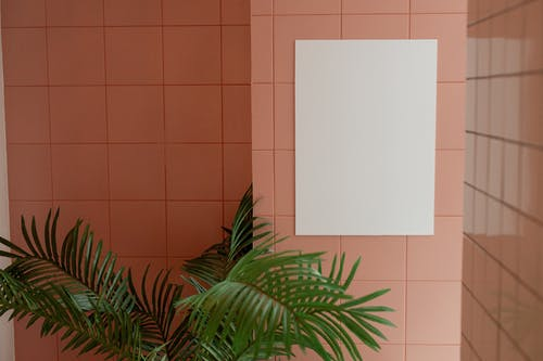 Blank poster hanging on wall with ceramic tile