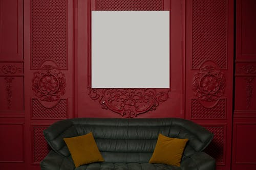 Empty painting hanging on wall in stylish room