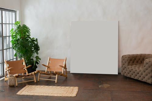 Interior of light room with empty paint placed near wall