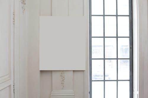 Blank frame on wall near window