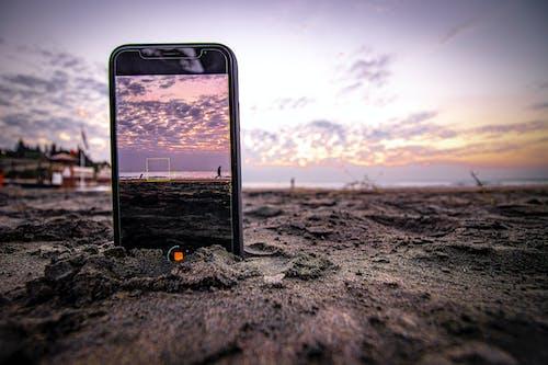 Black Iphone 4 on Beach