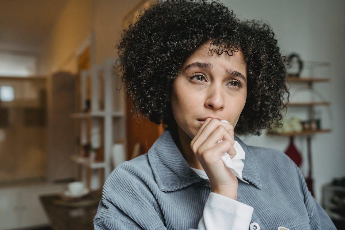 Crying upset black female with tissue