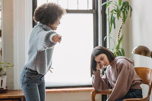 Diverse women fighting in room