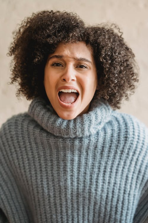 Smiling Woman in Gray Turtle Neck Sweater