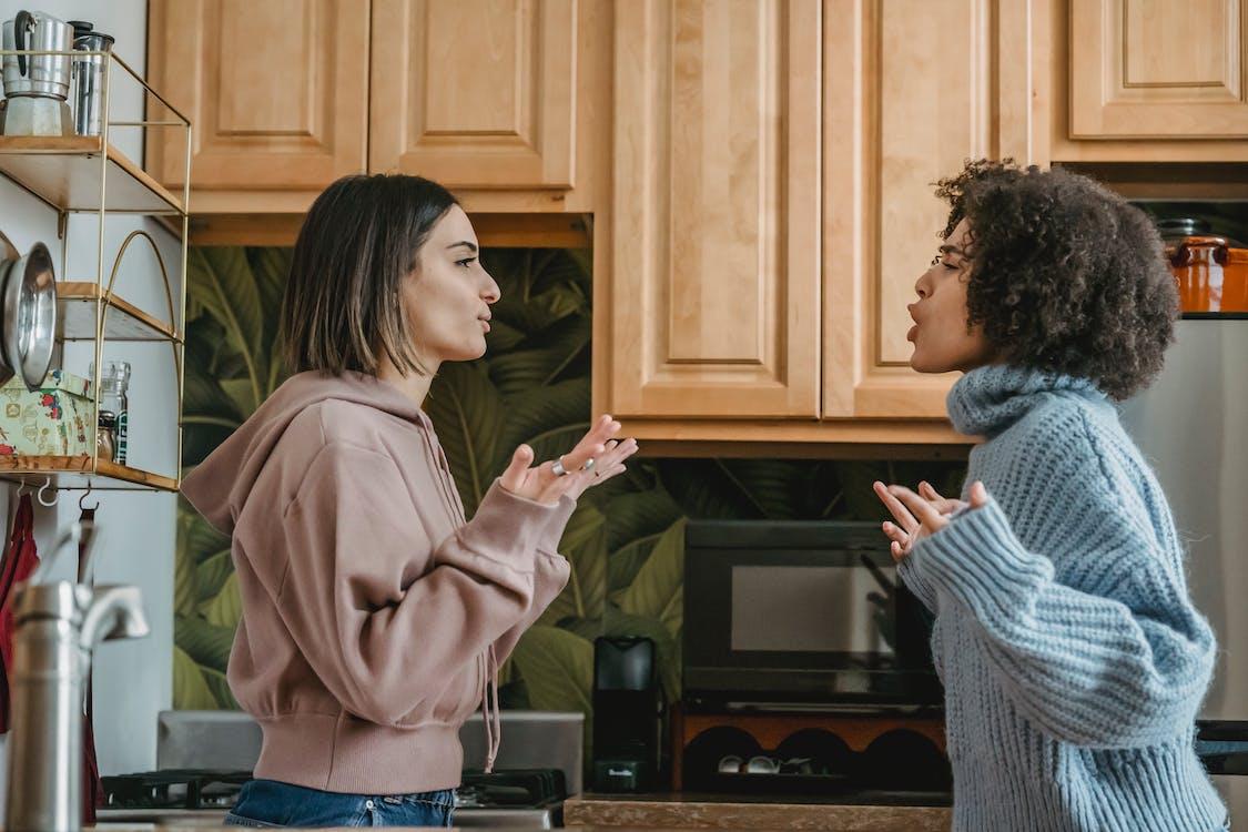 Multiethnic women having conflict in kitchen