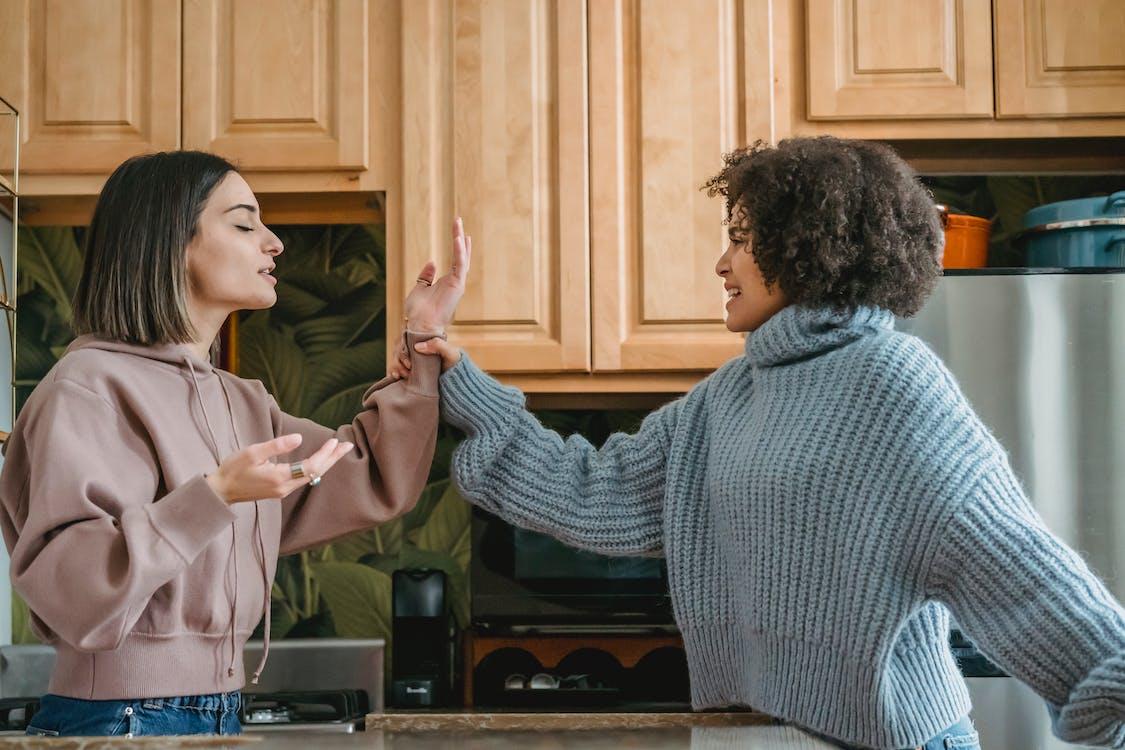 Multiracial ladies having disagreement in kitchen