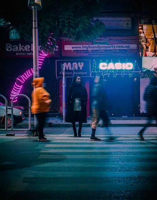 People Walking on the Pedestrian Lane