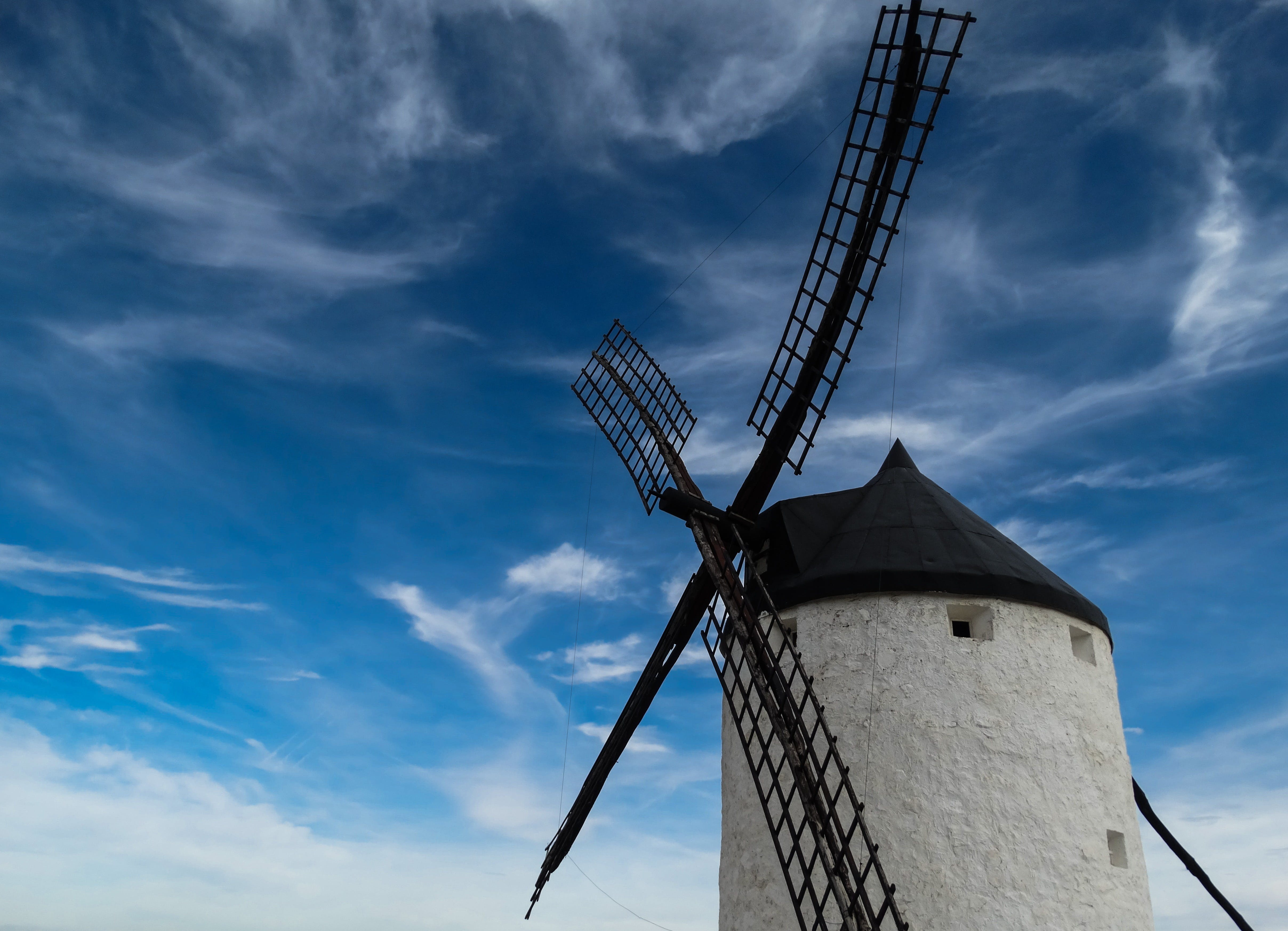 Black and White Windmill Tower and Clear Blue Sky