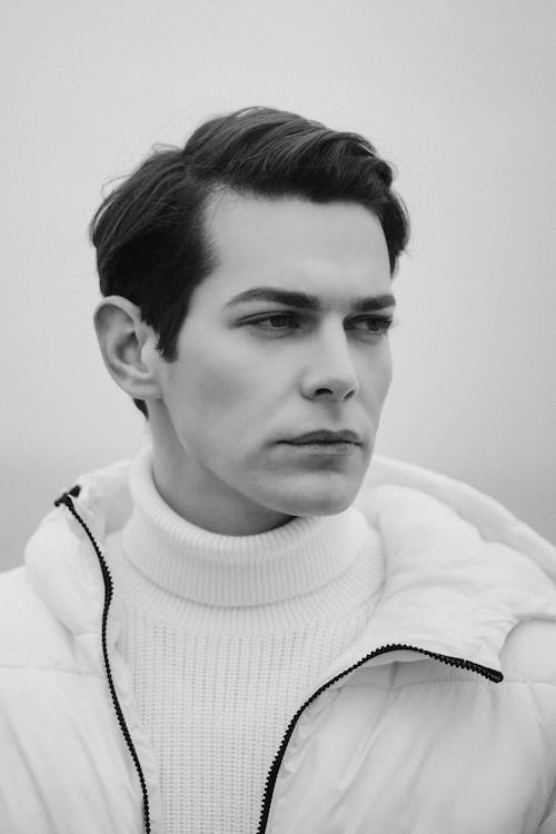 Man in White Turtle Neck Sweater