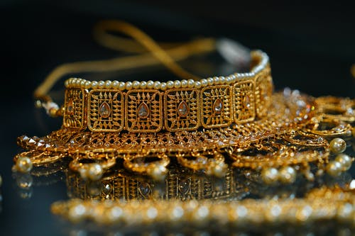 Golden precious oriental jewelry placed on table