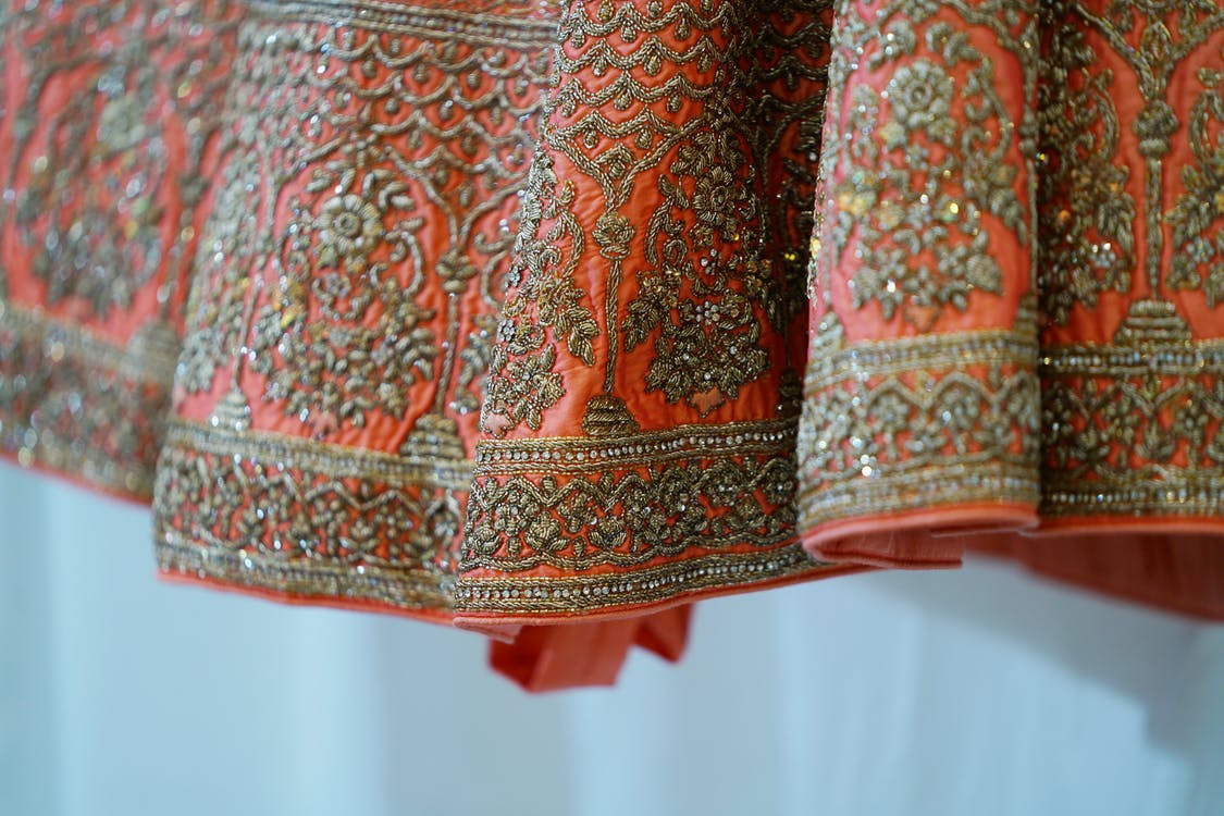 Traditional oriental maxi gown bottom of pink color decorated with ornamental embroidery and shiny beads and sequins