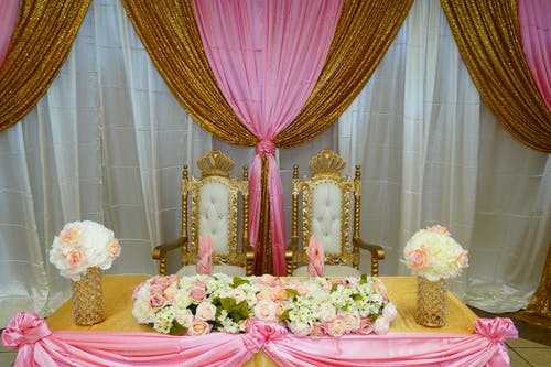 Elegant posh groom and bride table decorated with flowers for wedding celebration in fine restaurant
