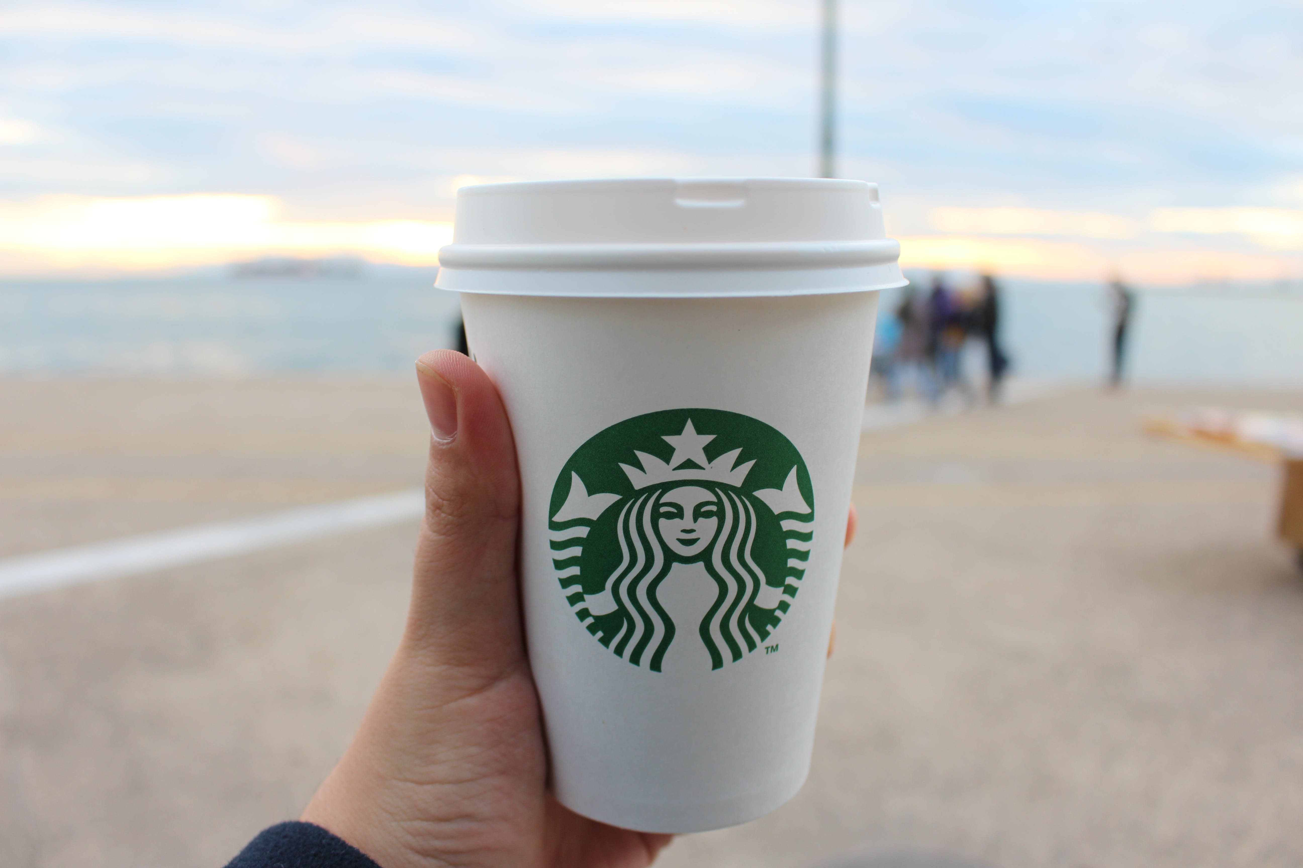 Person Holding Star Buck Plastic Cup