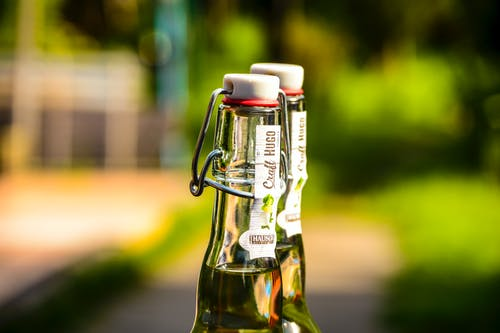 Selective Focus Photography of Two Clear Air Tight Bottles