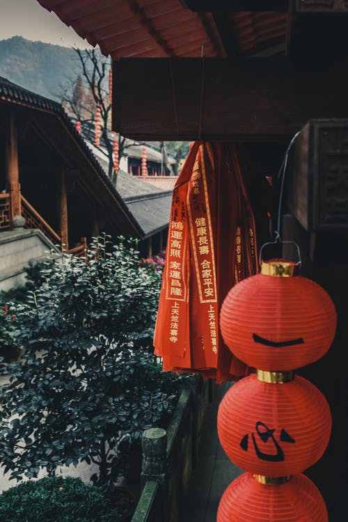 Traditional oriental red lanterns hanging on wall