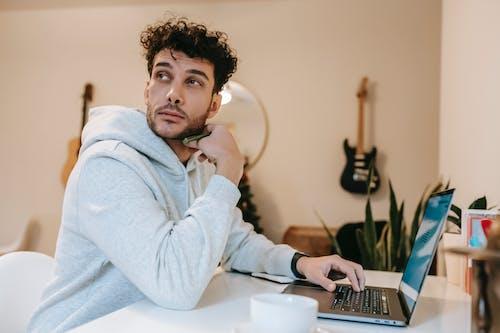 Focused freelancer using netbook at home in daytime
