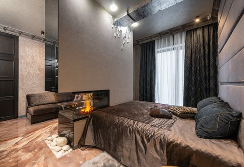 Room with bed and fireplace