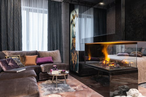 Cozy room with sofa and fireplace