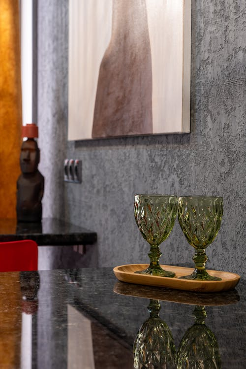 Decorative glasses on tray in house room