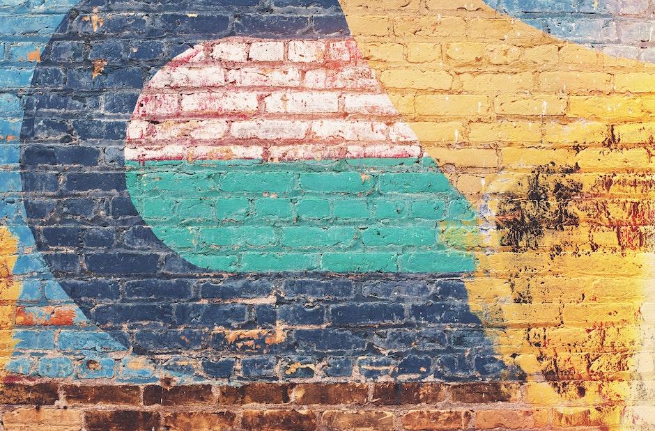 Yellow Green and Blue Brick Wall