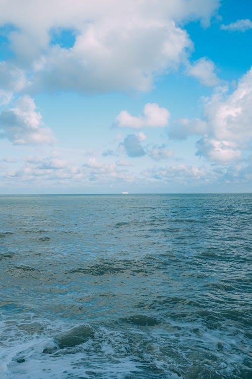 Wavy sea under clear blue sky