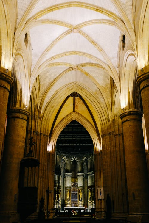 Interior of historic Gothic cathedral with arched golden ceiling and ornamental nave of Southwark Cathedral in London