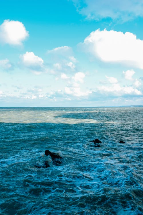 Endless azure seawater rippling and waving under clear blue sky on summer sunny weather
