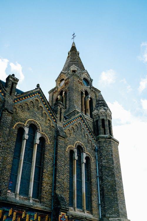 Facade of medieval brick church on sunny day