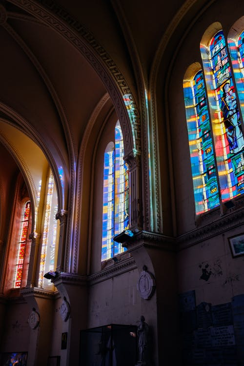 Interior of medieval cathedral with colorful leaded glass windows