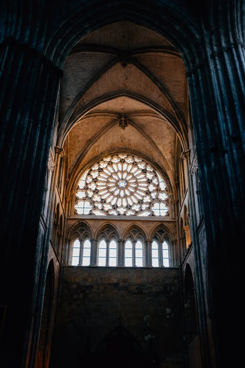 Interior of ancient Gothic style church with arched windows