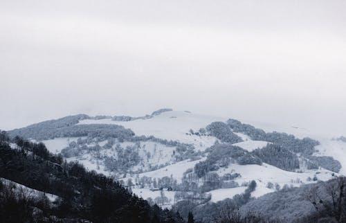 Snowy mountain ridge on cloudy winter day