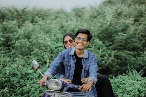 Happy Couple riding a Mopet