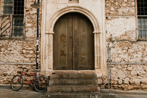Old stone building with arched wooden door