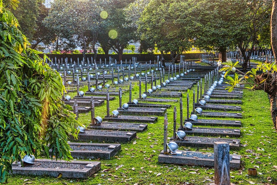 Gravestones with helmets in cemetery