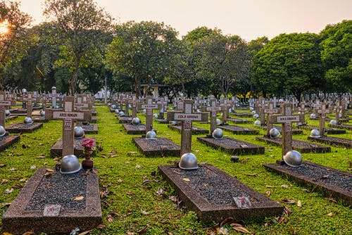 Aged heroes cemetery with tombstones