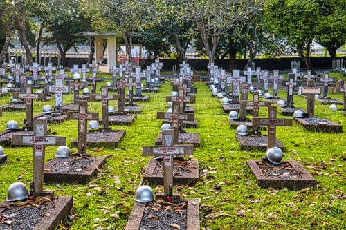 Cemetery with hardhats on military gravestones