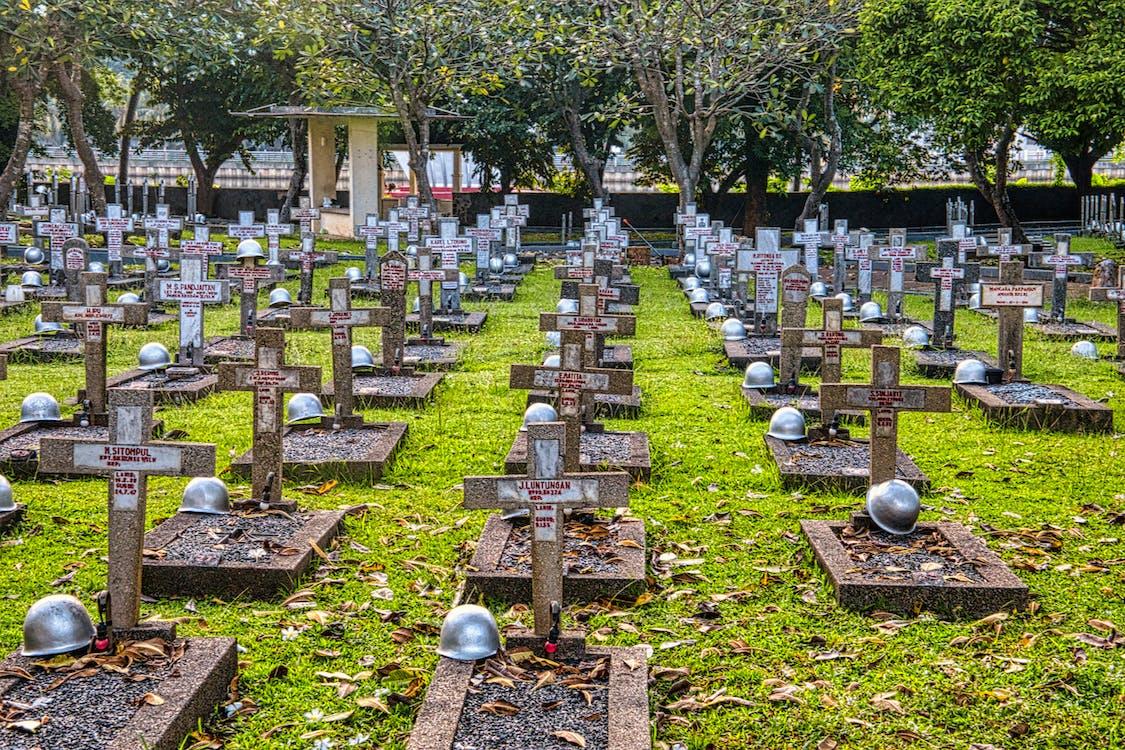Cemetery with hardhats on military gravestones