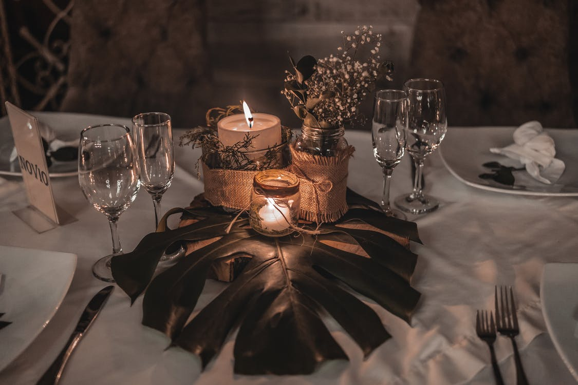 Banquet table with candles and tableware for celebration