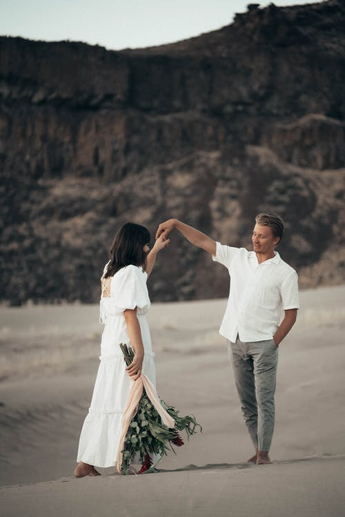 Loving newlywed couple on sandy terrain