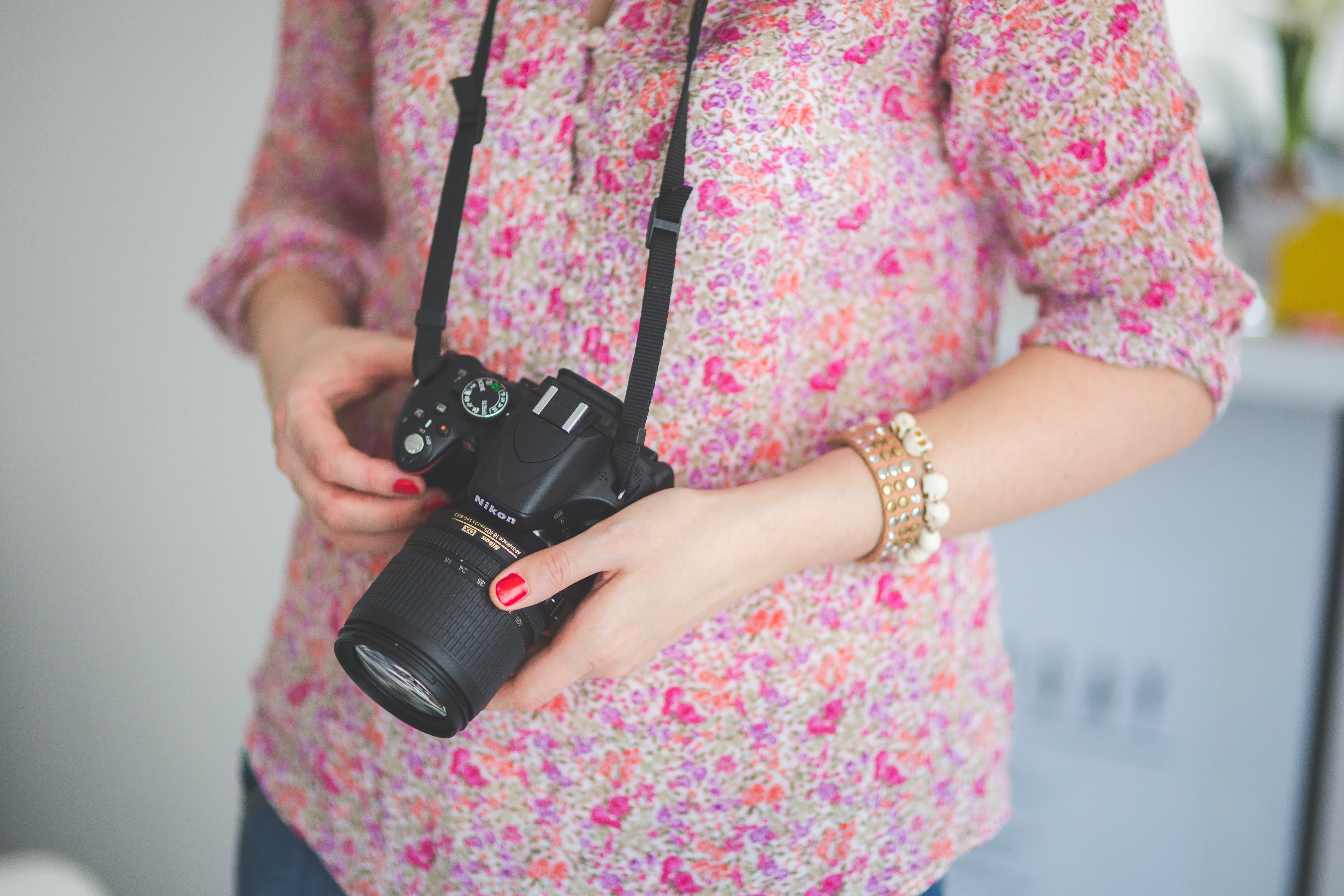 Female photographer holding a dslr camera