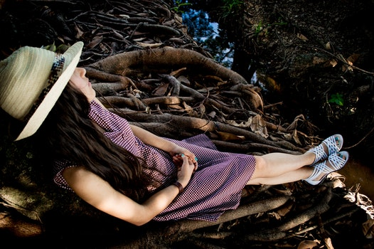 Woman Leaning on Brown Tree