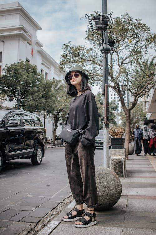 Woman in Black Hijab Standing Near Black Car