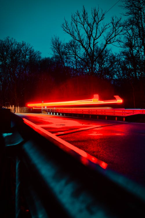 Red Light on Road during Night Time