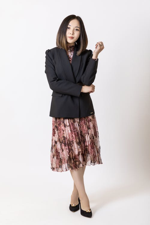 Woman in Black Blazer and Pink Skirt